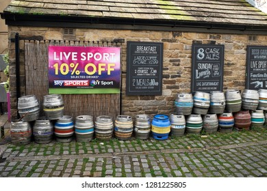 SKIPTON, NORTH YORKSHIRE, ENGALND, UK. 17TH OCTOBER 2017. Multicoloured aluminium beer casks lined up for collection outside a sports pub and bar