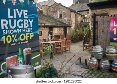 SKIPTON, NORTH YORKSHIRE, ENGALND, UK. 17TH OCTOBER 2017. Outside eating area and  multicoloured aluminium beer casks lined up for collection outside a sports pud and bar