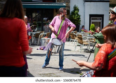 Skipton, North Yorkshire / UK - July 5th 2015: The leader of a Samba drumming group play at the annual Skipton Sheep Day event.