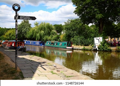 Skipton North Yorkshire UK July 11 2018 Narrow boats moored  on the leeds to Liverpool canal on a hot sunny day - Editorial