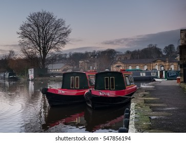 Skipton, United Kingdom - December 29, 2016: Two narrow boats in the Leeds Liverpool Canal in Skipton, North Yorkshire, England.