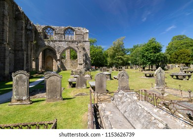 Skipton,North Yorkshire,United Kingdom.6.24.2018.Bolton Abbey with a Graveyard in the foreground.