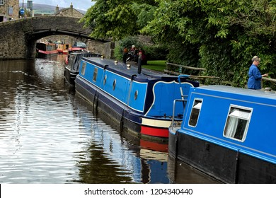 Skipton,North Yorkshire,United Kingdom.8.24.2017.Blue Barges moored to the bank of a Canal in England,UK.