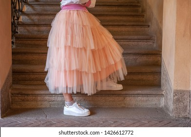 skirt worn and matched with white snikers