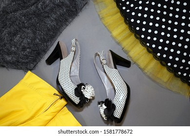 skirt with yellow petticoat, black ,grey fur and white shoes on a gray background