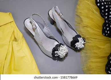 skirt with yellow petticoat, black and white shoes on a gray background