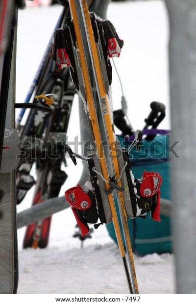 skis leaning on rack