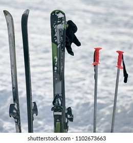 Skis with poles for active winter vacation in mountains
