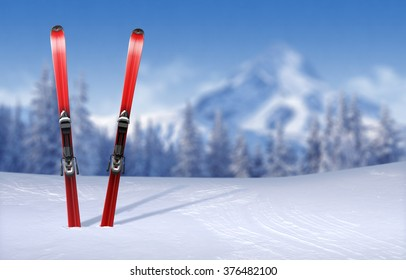 Skis stuck in snow-covered plain - out-of-focus wintertime pine forest and mountain peak background with copy-space