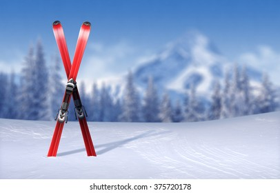 Skis in X-form stuck in snow-covered plain - out-of-focus wintertime pine forest and mountain peak background with copy-space