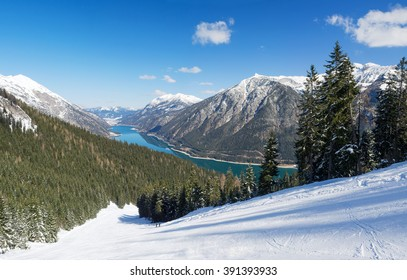 Ski-slope at Lake Achensee with snow-covered trees, Pertisau, Tyrol, Austria