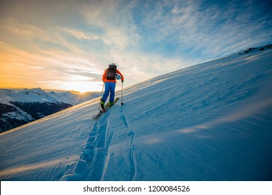 Skitouring with amazing view of swiss famous mountains in beautiful winter powder snow of Alps.
