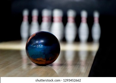 skittles and bowling ball on the playing field