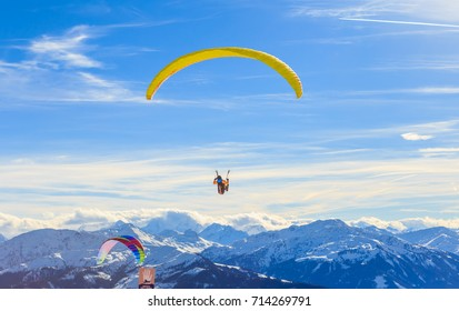 SKIWELT, AUSTRIA - FEBRUARY 2, 2017: Paragliding over the mountains in winter. Ski resort  Hopfgarten, Tyrol, Austria