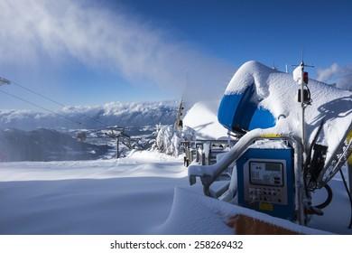 SKIWELT, AUSTRIA - January 26, 2015: Snow machine in use at the ski piste  on 26 of January, Westendorf, Austria