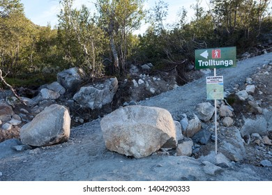 SKJEGGEDAL, NORWAY-CIRCA JUL, 2018: Signpost showing direction to Trolltunga or Troll Tongue with No camping notice. The popular tourist destination in Hordaland county with path about 7 km one way