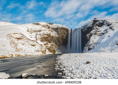 Skogafoss - The famous waterfall in winter, southern Iceland.