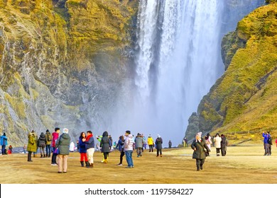 Skogafoss, Iceland - January 29, 2017 : View of Skogafoss waterfall with lots of tourists visiting in the morning in winter in Iceland on January 29, 2017.