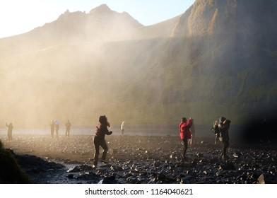 Skogafoss, Iceland - October 16, 2017: People in water mist at Skogafoss waterfall in Iceland