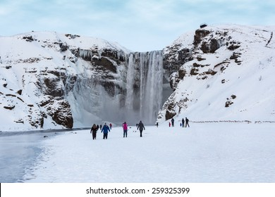Skogafoss Waterfall Attracts Visitors during Winter in Iceland
