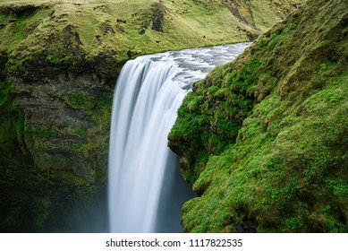 Skogafoss waterfall and green grass, Iceland. Beauty in nature