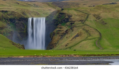 The Skogafoss waterfall in the south of Iceland at the cliffs of the former coastline