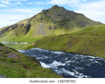 Skogar, Iceland / Iceland - August 2018: River flowing into Skogafoss waterfall