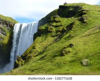 Skogar, Iceland / Iceland - August 2018: Skogafoss waterfall area in Skogar