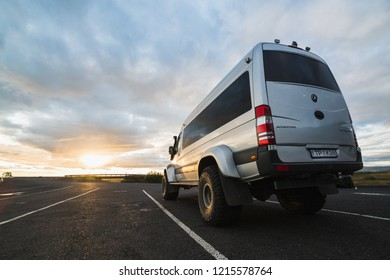 SKOGAR, ICELAND - AUGUST 2018: Super jeep bus with big wheels on the road during the sunset in Iceland.