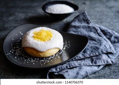 Skoleboller - traditional Norwegian buns with custard filling, sugar glazing and sprinkled with shredded coconut