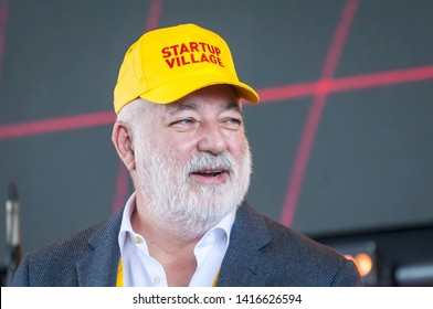 SKOLKOVO, MOSCOW, RUSSIA. May 29, 2019. Russian Jewish businessman Victor Vekselberg in a yellow cap speaking at the Skolkova Startup Village annual international innovations conference opening event.