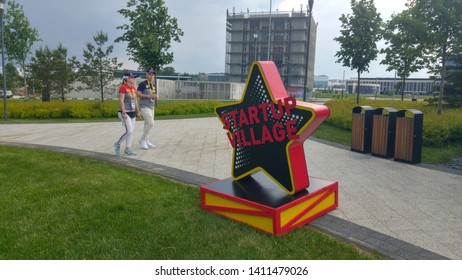 SKOLKOVO, MOSCOW, RUSSIA. May 30, 2019. Young volunteers walking through a Skolkovo Startup Village during the annual startup fair