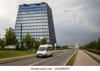 SKOLKOVO, MOSCOW, RUSSIA. May 30, 2019. The general view of the Hypercube building in the Skolkovo Innovation park with a Mercedes Sprinter shuttle bus in the front.