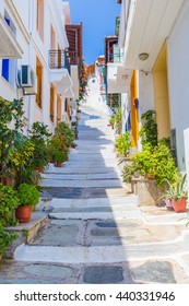 Skopelos, Greece - 27 July 2015: View of steps leading up a narrow path in Skopelos Town on the islands of Skopelos. Images from the Greek Sporades Islands, a popular tourist destination.