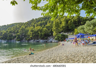 SKOPELOS, GREECE - JULY 2017: Wonderful typical beach of Skopelos island, Greece. Skopelos is a beautiful Greek island that attracts mostly families and romantic couples.