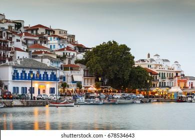 Skopelos, Greece - June 14, 2017: Evening view of the harbour of Skopelos town, Greece.