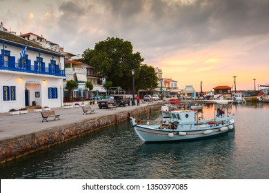 Skopelos, Greece - June 15, 2017: Town hall and the port of Skopelos town, Greece.