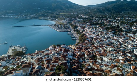 Skopelos harbor and the Old Town, island of Skopelos, Greece, Northern Sporades in the Aegean Sea - Panoramic Drone Photo