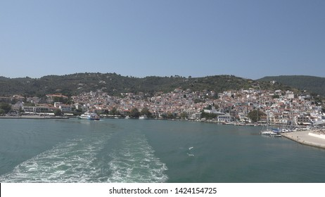 SKOPELOS ISLAND – GREECE, 28 AUGUST, 2018, 4K POV Point of view of Skopelos port old town panorama by day, cruise sailing trip