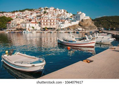 Skopelos town, Greece - 05 29 2013 : Panoramic view over Skopelos town at Skopelos island in Greece on a sunny day