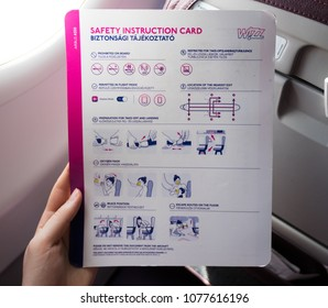 """""""Skopje, Macedonia - 04.25.2018: Wizz Air Safety Instruction Card on an Airplane."""""""