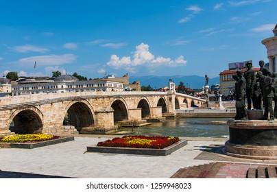 Skopje, Macedonia - August 26, 2017: Skopje Stone bridge over Vardar river near main square in Skopje, capital city of Macedonia