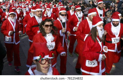 SKOPJE, MACEDONIA - December 24, 2017: People in Santa Claus costumes take part in the annual race in downtown Skopje, participating individuals and families, December 24, 2017, in Skopje, mac