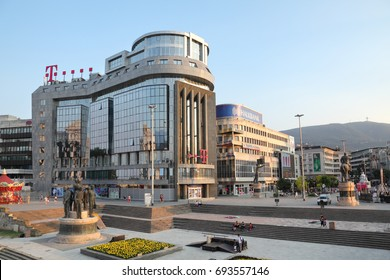 SKOPJE, MACEDONIA - JULY 26 2013:  T-Mobile building in center of city with people at street July 26, 2013, T mobile is leading operator in Macedonia