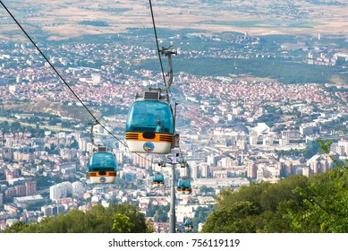 SKOPJE, MACEDONIA. July 5, 2016. Cable car elevator with city Skopje in background. Tourists visiting top of vodno mountain using the cabin service near Skopje, Macedonia.