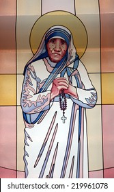 SKOPJE, MACEDONIA - MAY 17: Stained glass window with the image of Mother Teresa in the Memorial House in Skopje, Macedonia on May 17, 2013