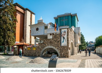 SKOPJE, MACEDONIA - SEPTEMBER 23, 2016: Front view of Mother Theresas memorial church in the city center of Skopje Macedonia September 23, 2016. Incidental people walking by.