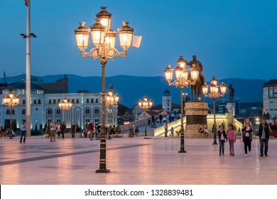 SKOPJE, MACEDONIA - SEPTEMBER 24, 2016: Night scene with people walking at the city square illuminated with decorative street lights in Skopje September 24, 2016.
