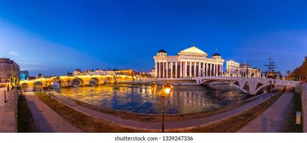 SKOPJE, NORTH MACEDONIA, 05 January 2019 - Skopje City Center at evening - panoramic view. Architecture and buildings of Skopje. Archaeological Museum, Stone Bridge, Bridge Eye.