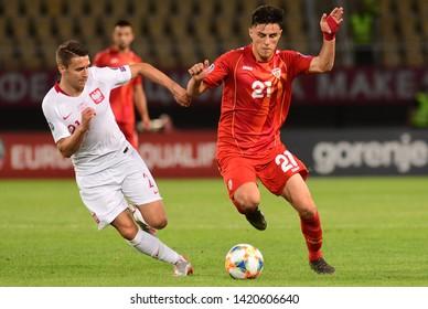 SKOPJE, NORTH MACEDONIA - 06/08/2019: Elif Elmas from North Macedonia with Poland Przemyslaw Frankowski in the UEFA Euro 2020 qualification match in Skopje.